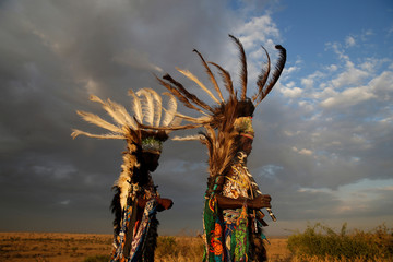 Dancers from the Kurya community are seen before performing in front of visitors to the Singita Grumeti Game Reserve