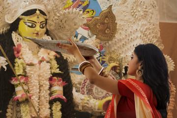 Bengali Married Woman worshipping goddess durga with Bamboo Tray Wall mural