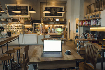 Laptop with blank screen in coffee shop