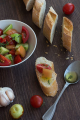 organic salad and sliced french bread