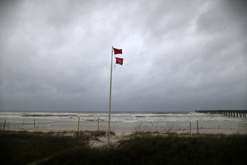 A red warning flag is seen as Hurricane Michael approaches Panama City Beach