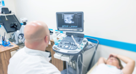 Unsharp medical background of ultrasound examination room. Without focus medical background of the ultrasound apparatus in the medical office for examining patients. Ultrasound diagnosis of diseases