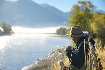 fly fisherman drinking a coffee