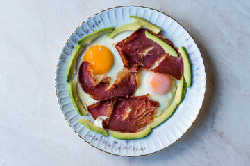 Fried Egg with Bacon Pastirma / Pastrami and Avocado Slices for Breakfast.