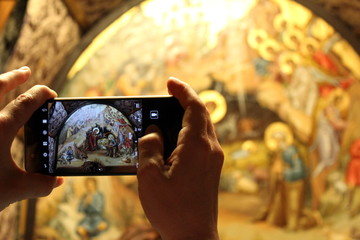 Taking a photo of the Grotto of the Nativity