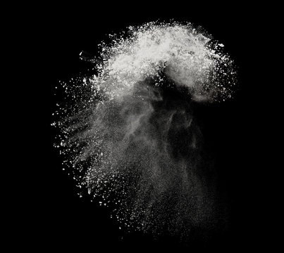 White powder or flour explosion isolated on black background  freeze stop motion object design