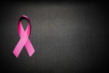 Pink ribbon for breast cancer awareness, symbolic bow color raising awareness on people living with women's breast tumor illness. bow isolated with clipping black background