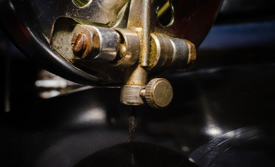 fragment of an old gramophone with a vinyl record