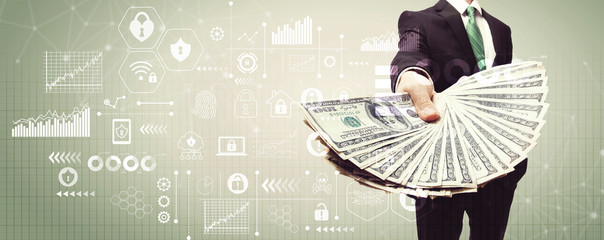 Cyber security theme with business man displaying a spread of cash