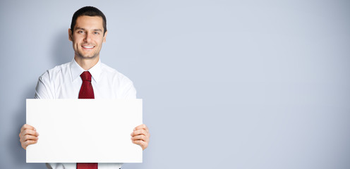 Businessman showing blank signboard