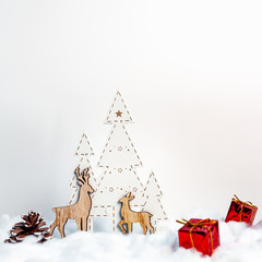 Christmas card with wooden Christmas trees, reindeers and red presents with white copy space background