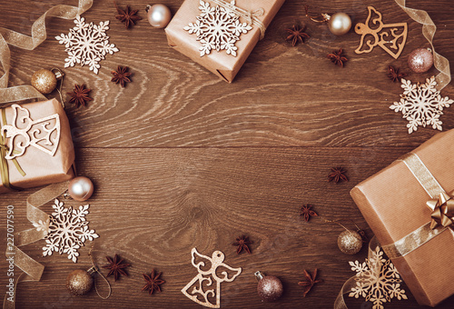 christmas handmade gift boxes decorated with craft paper branch and snowflake on dark background top