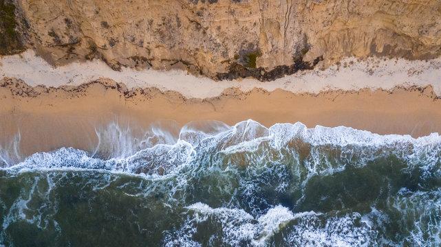 Drone view of waves hitting the beach at Half Moon Bay in San Francisco California