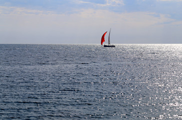 Photo of the sea bright beautiful landscape with waves and a boat