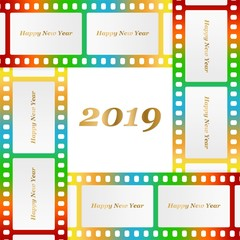 New year greetings for 2019 with colorful blank film and photographic window with golden inscription Happy new year and number 2019 on a background of color film strips