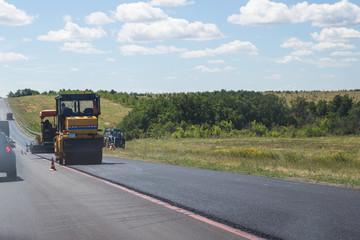 paver machine working on road repair