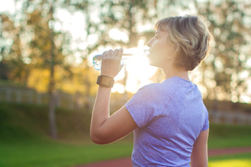 Healthy Lifestyle. Portrait Of Young Woman With Bottle Of Water At Stadium. Healthcare. Drinks. Health, Sport, Beauty, Diet Concept.