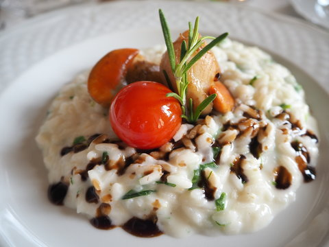 Risotto with seafood with cherry tomatoes and balsamic vinegar