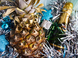 festive composition with pineapple and champagne in a decorative box