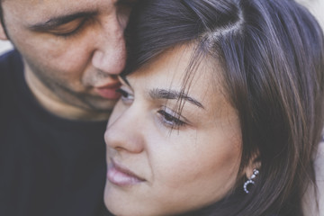 Close up of romantic husband kissing his wife