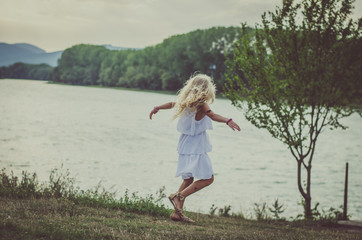 lovely child  dancing at the lake
