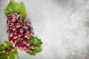 Red grapes over stone table. Top view with copy space Wall mural
