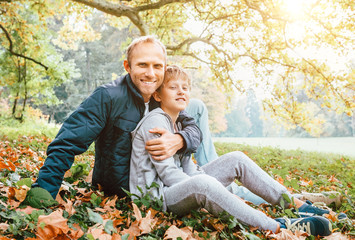 Wall Mural - Father and son autumn portrait