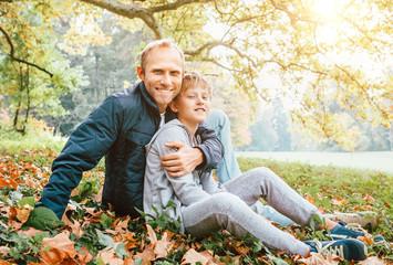 Fototapete - Father and son autumn portrait