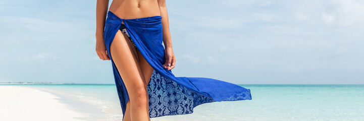 Beach summer body woman banner. Skin care leg laser epilation hair removal sexy legs in fashion blue pareo skirt wrap women. Luxury travel panorama copy space crop.