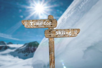 Time for skiing. Information sign and blurred background.