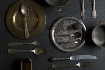 Vintage kitchen utensils on a dark stone background