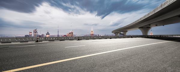 Fototapete - empty asphalt highway with modern cityscape new york