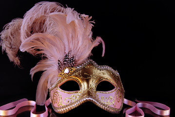 Venetian mask of pink color on an even isolate.