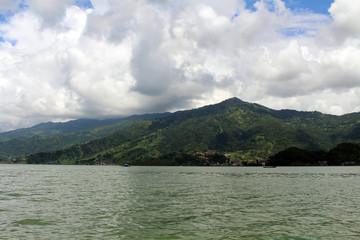 Boats around Phewa Lake and hills in Pokhara, a popular tourist destination