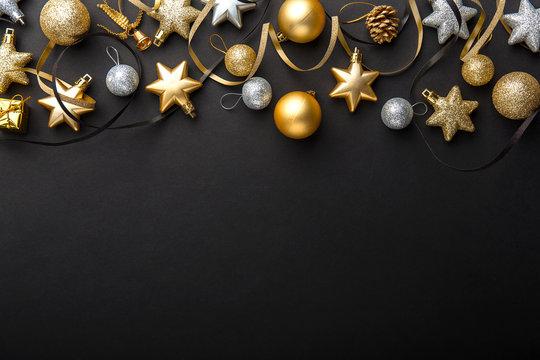 Golden silver christmas deco on black