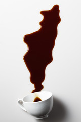 cup of coffee spilled on white background