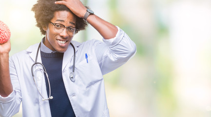 Afro american neurologist doctor or psychology man over isolated background stressed with hand on head, shocked with shame and surprise face, angry and frustrated. Fear and upset for mistake.
