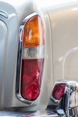 Rear tail light cluster on classic vintage car. Slightly simplified image.