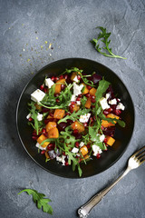 Pumpkin salad with beetroot, arugula and feta cheese.Top view.