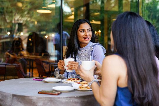 Businesswomen relaxing in cafe