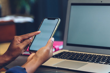 Close up of businesswoman's hands using cell phone in office