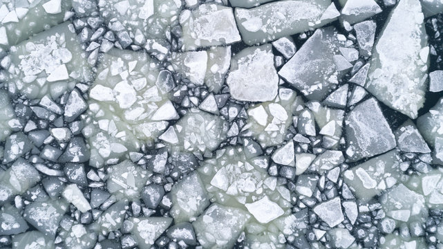 floating ice floes on water, aerial view