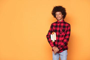 African american teenage boy posing.