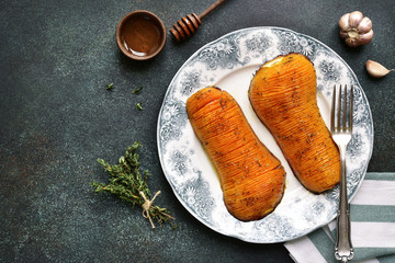 Halves of butternut squash baked with honey and herbs on a vintage plate .Top view.