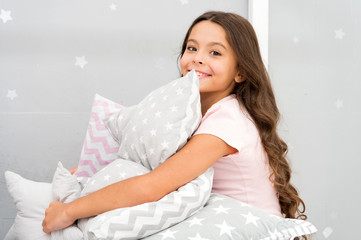 Girl kid hug cute pillow. Cute kids pillows they will love to cuddle. Find decorative pillows and add fun to room. Happy childhood cozy home. Adorable cushions for your child room