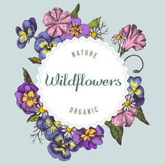 Round paper emblem over wildflowers. Hand drawn vector illustration