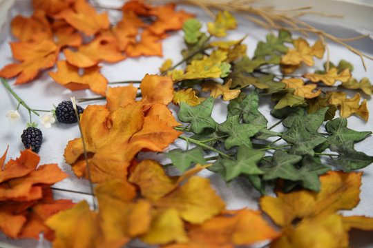 Leaf cake decorations can be seen in the kitchen before they are added to the red velvet and chocolate wedding cake for the marriage at Windsor Castle of Britain's Princess Eugenie and Jack Brooksbank, at Buckingham Palace in London