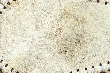 Grungy leather texture of a used baseball