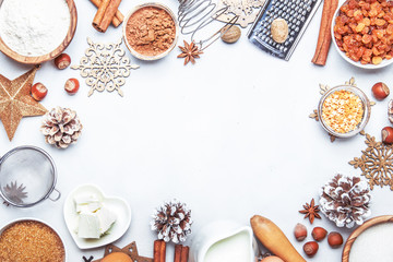 Christmas or New Year composition with ingredients for baking festive cookies, with golden snowflakes, Christmas balls, pine cones on white background, top view