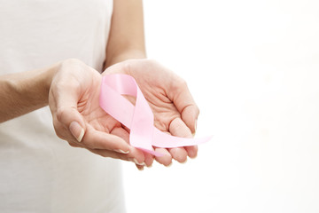 Woman holding a pink ribbon.